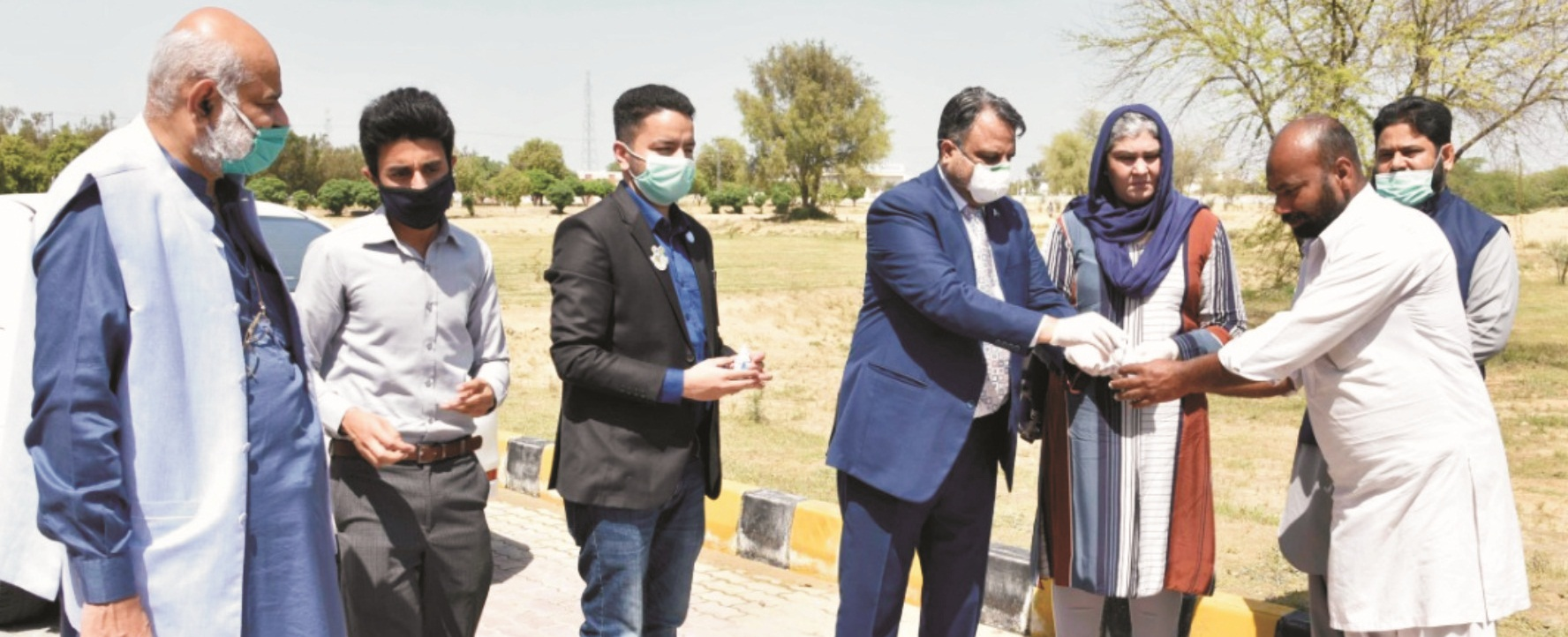 Worthy Vice Chancellor distributing hand sanitizers among on duty employees
